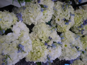 White and blue arrangements waiting to be on their way to the reception.