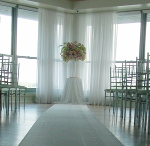 A white aisle runner led the bride and groom into this light hearte oasis which was their ceremony