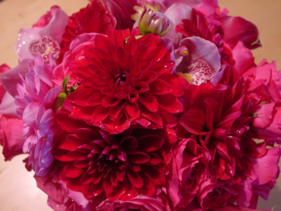 Pink roses, cymbidium orchids and red dahlias formed the Bridal bouquet.