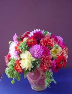 Colorful autumn arrangements of dahlias and zinnias embellished each table.