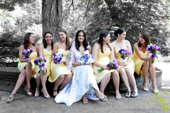 Bridesmaids in yellow dresses with lavander purple flowers