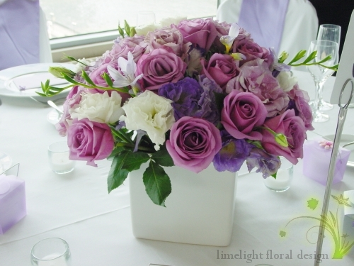 Lavender and silver centerpieces of Cool Water roses, purple Lisianthus and fragrant freesias were placed on tables.
