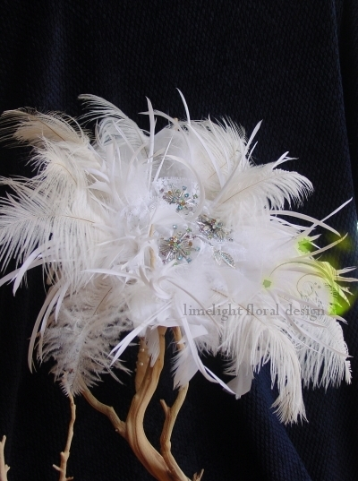 This white feather bouquet is made of white ostritch feahers and beautiful costume jewelry.