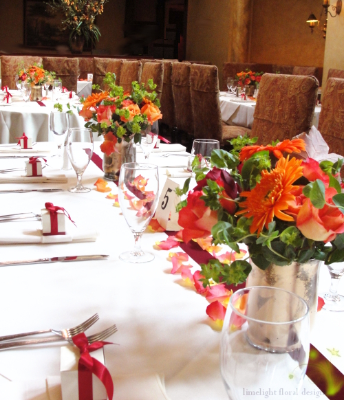 gold red and orange garden wedding centerpiece