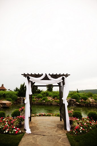 Garden Arch setting for outdoors ceremony.