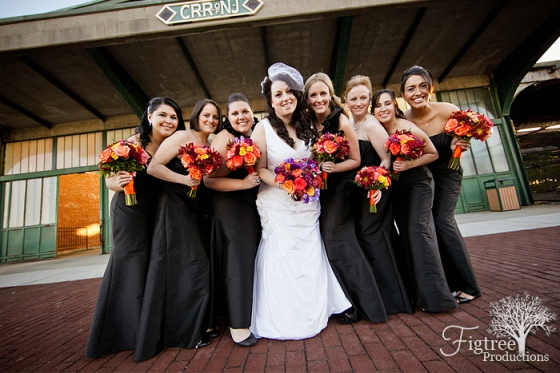 Liberty House Restaurant wedding flowers bridesmaids in black dress with orange flower bouquets