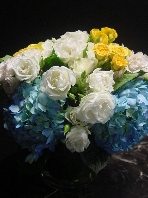 Charthouse wedding centerpieces yellow white and blue