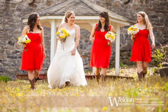 Bridal party bridesmaids with yellow flower bouquets in red dresses. Weldon Photography