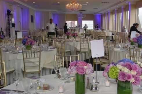 NJ Wedding Flowers Limelight Floral Design Purple and blue centerpieces at Waterside restaurant, purple roses, blue hydrangeas, multiple centerpieces per table