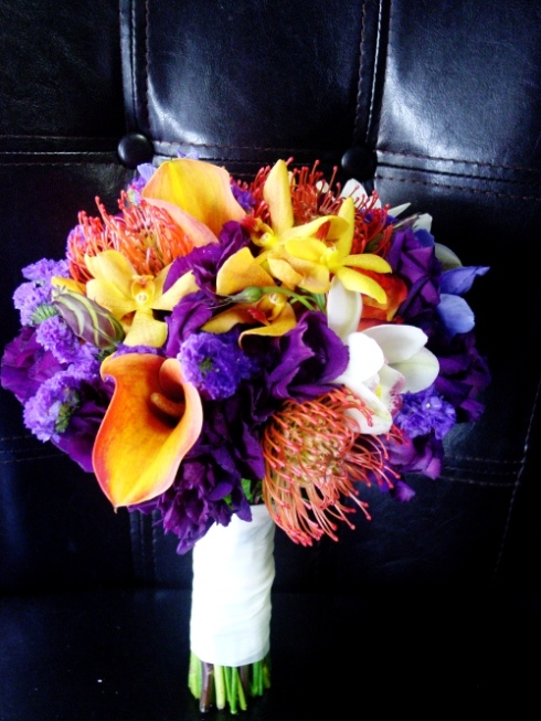 Bridal Bouquet in purple and orange mokara orchids, callas, pin cushions in Hoboken Wedding