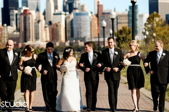 Bridesmaids in Black with white flowers at Liberty State Park Maritime Parc