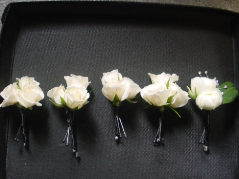 boutonnieres of majolica roses