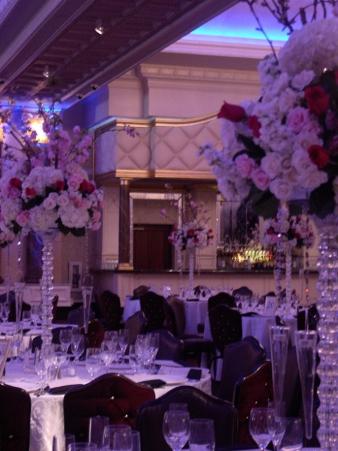 Myer finishing touches on white and pink centerpieces with cherry blossom branches at the Venetian NJ