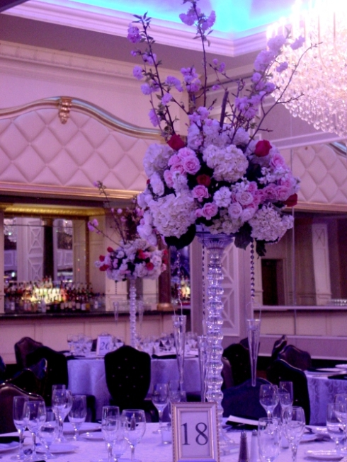 Myer finishing touches on white and pink centerpieces with cherry blossom branches