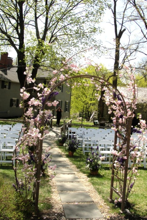 The Inn at Millrace pond pink and purple wedding ceremony arch garden