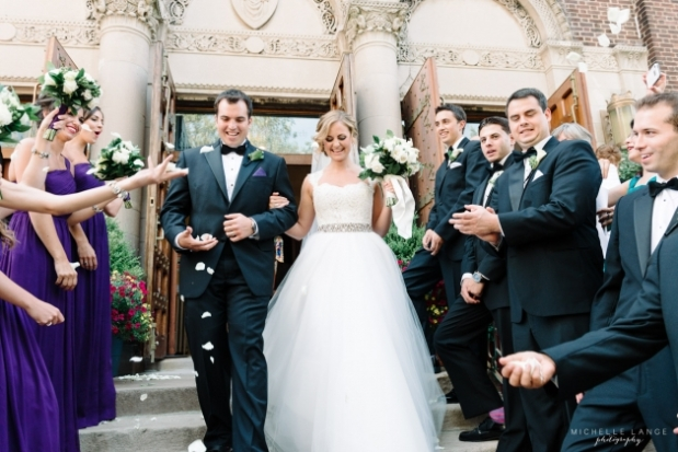 Bride exit with petals from church at Hoboken NJ wedding Bridesmiads bouquet of white roses and green foliage