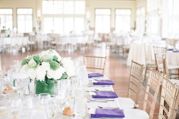 White and Green Wedding centerpieces at Liberty House Restaurant. wedding guest table with white mums, green mums, hydrangeas, sweet williams, green trick and green foliage