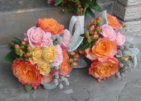 Bridesmaids bouquet of orange and pink roses with gray lambs ears in Hoboken NJ