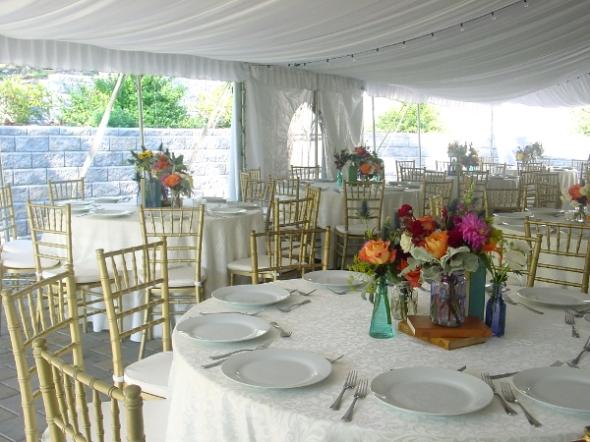 Books and mason jars multiple vase centerpieces at millrace Pond Inn Hope NJ by Limelight Floral Design Hoboken NJ