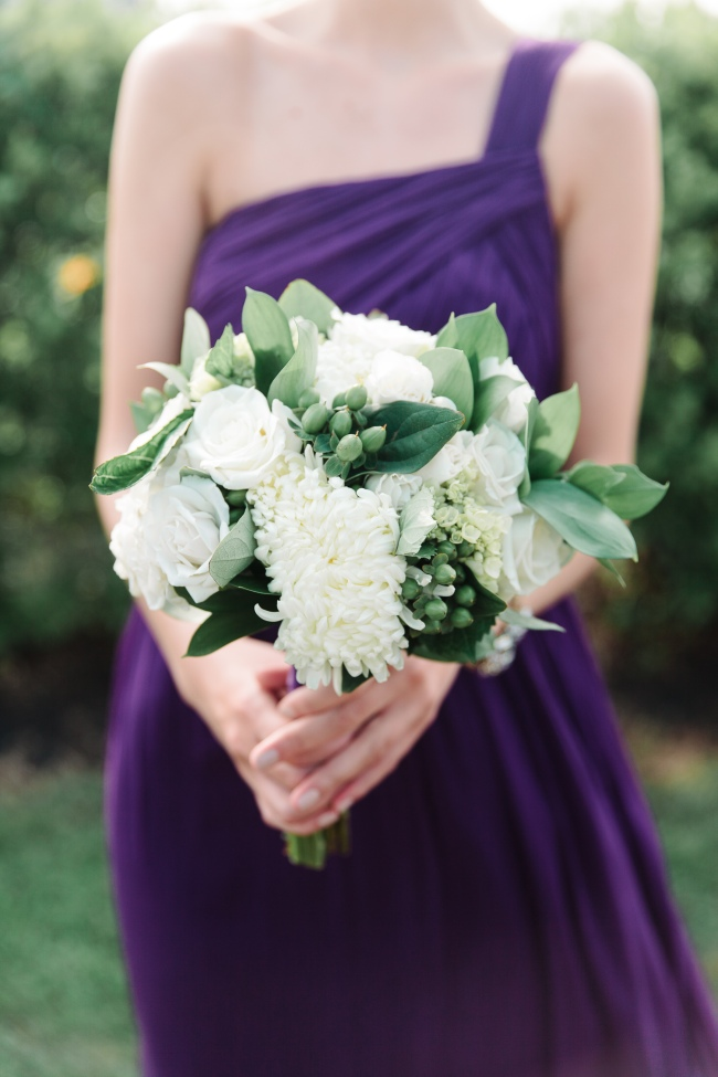 Bridesmaids bouquet green and white on purple dress