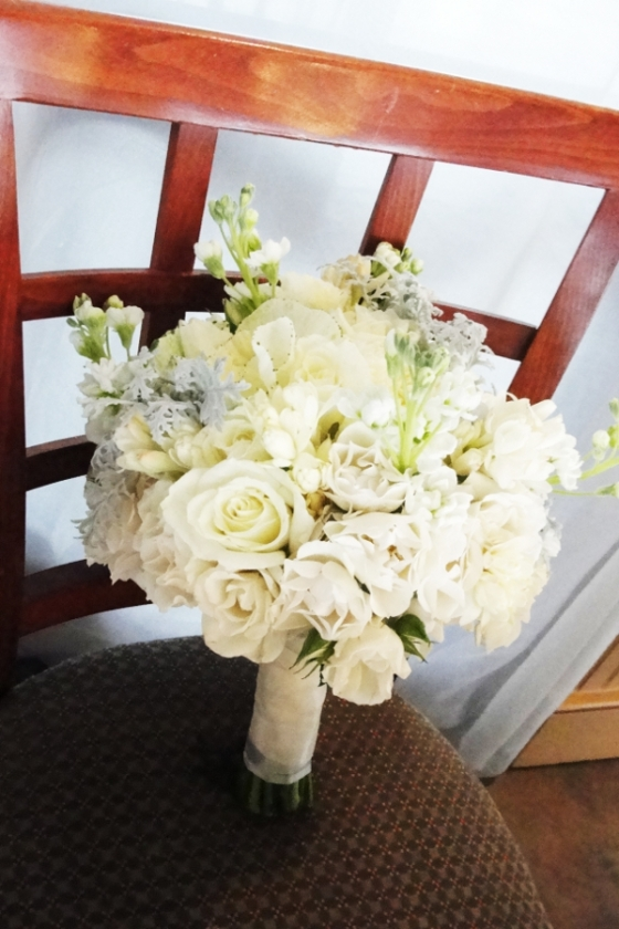 bridal bouquet gray and white with roses, kale and stock